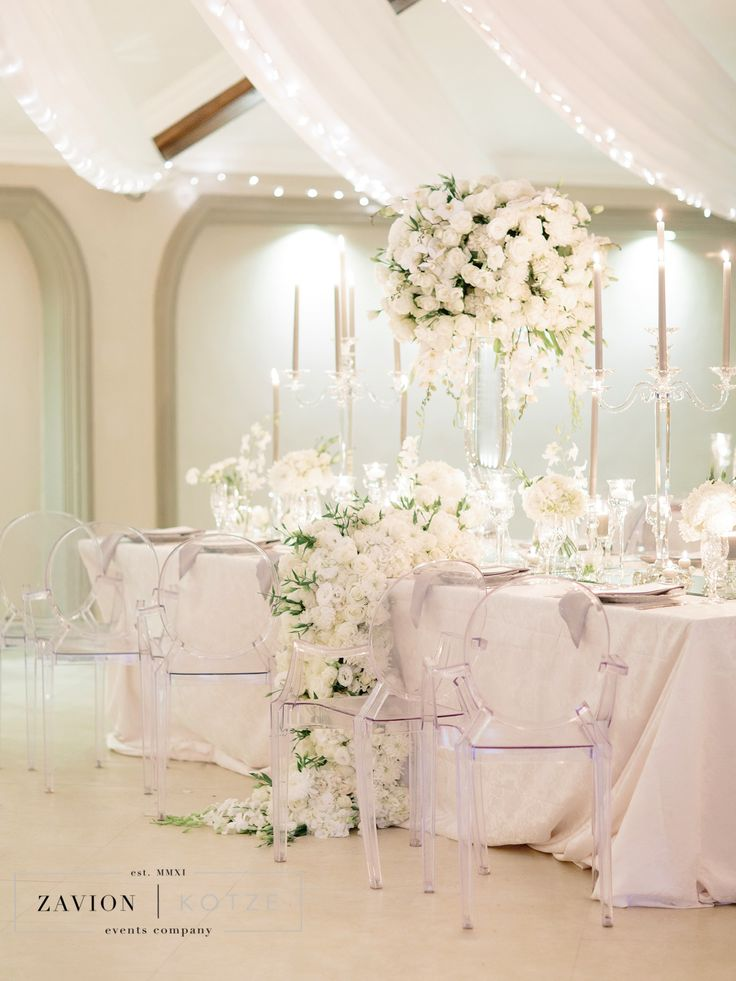 Crisp white flowers, softened by champagne table cloths and soft candle light. Floral runner with orchids and white roses. Luxe Wedding, Royal Wedding, Orchids, mass arrangements, large wedding flowers, luxury wedding.Photographer Rensche Mari