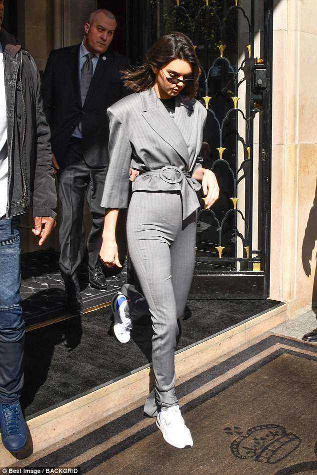 1f6ca6d920a Kendall Jenner cuts a chic figure in a fitted grey suit