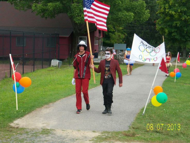 Summer Camp theme day ideas: Olympic Flag Bearers-We have a great opening ceremony tradition at Rosmarins Day Camp.  We have our staff, dressed in our Olympic theme, present the American Flag as well as our Camp Olympic Flag.  2013 was the Battle if the Bands, Rock vs Pop!