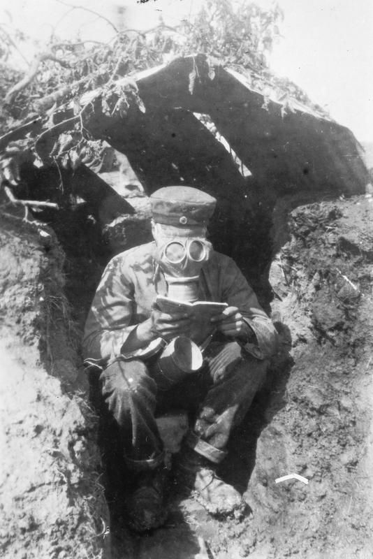 German artilleryman wearing his gas mask whilst in a battery position near Les Boeufs on the Somme.