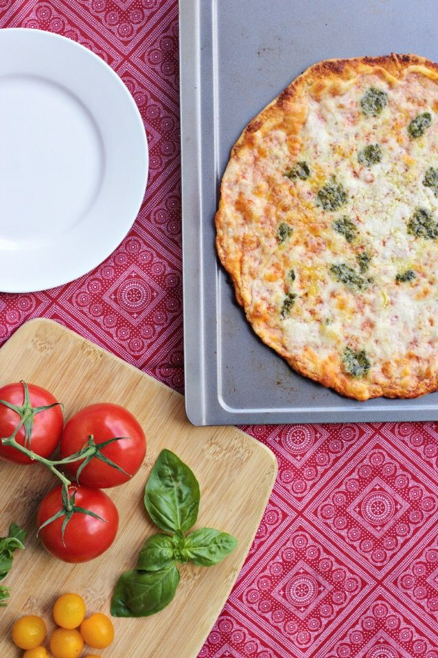 fancied up frozen pizza with pesto, fresh tomatoes + basil | pair with a big salad for an easy family dinner idea