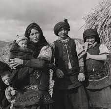 A Florina peasant family wearing traditional costumes, Greece, 1947.