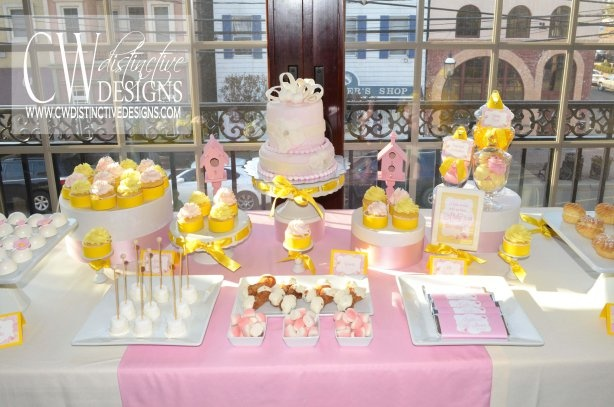 Pink & yellow baby shower dessert table