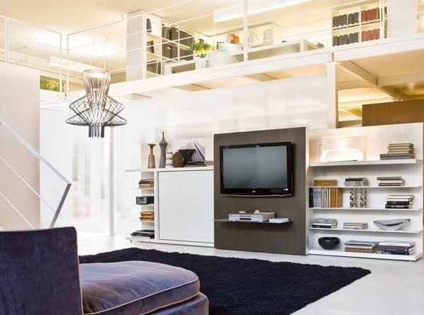 Poppi Theatre: mueble de salón con cama abatible escondida. Mueble convertible de salón, con librería, panel deslizante para TV, y cama abatible escondida. Es una práctica y moderna solución para hogares pequeños. La televisión va montada sobre un panel deslizante, y la cama está escondida en otro panel que es abatible. Deslizando la TV, ya se puede abatir la cama.  #Muebles, #Vídeos