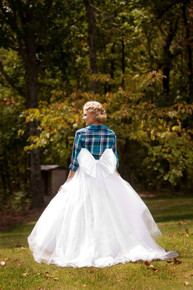 Love the flannel shirt and huge bow - rustic yet girly.  Photo by Andrea Murphy Photography. www.wedsociety.com  #wedding #brides #bow