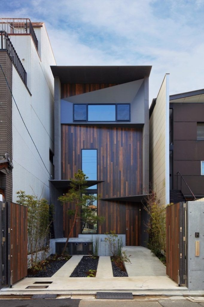 Three-Story House Squeezed Between A Street And A River