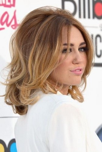 Miley's long layers with a medium length bob gives her tons of volume.