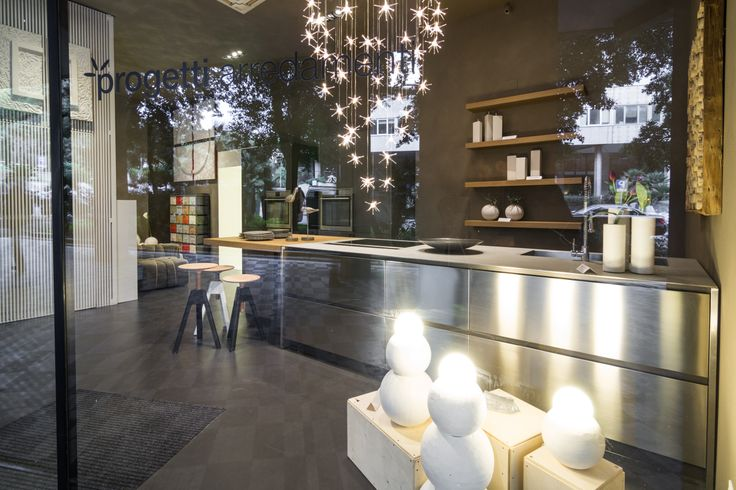 The renovated shop window of our partner Cesar Store Genova - Progetti Arredamenti: the new Maxima 2.2 combines stainless steel inox and eco cement tall-units  #design #kitchen #interiors #interiordesign