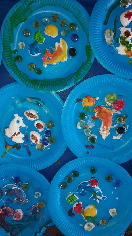 A fun craft for children of all ages. I made ceramic dolphins and sea shells which the children painted and glued onto blue paper plates. They then glued on shiny glass stones to finish off their underwater themed murals.