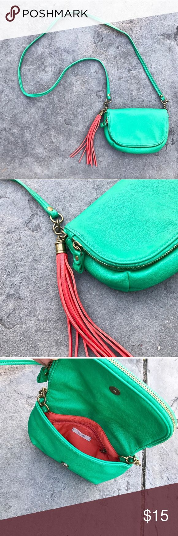 Urban Outfitters Purse A statement making green shoulder bag from Urban Outfitters. Ecote is the marked brand. It has a red/orange interior and tassel. Multiple pockets. Urban Outfitters Bags Crossbody Bags