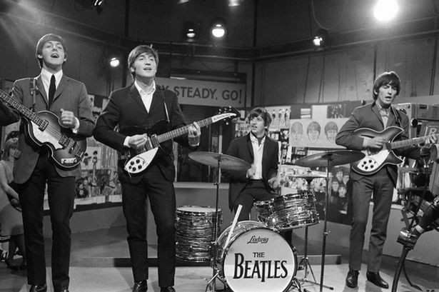 """The Beatles at Television House, Kingsway, for an appearance on the television Show """"Ready, Steady, Go"""" Left to right: Paul McCartney, John Lennon, Ringo Starr and George Harrison pictured playing on stage. 20 March 1964"""