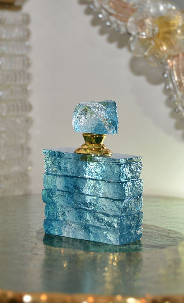 stunning light blue Liuli crystal perfume bottle with textured finish; With its unique look and style, this crystal perfume bottle is truly a work of art
