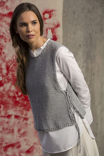 This reversible tabard vest can be worn with the sides open or totally laced-up.