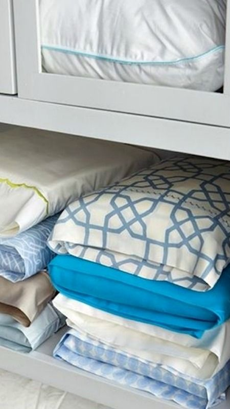 How to Organize your Bed Linens ~ Store your flat sheet, fitted sheet, and pillow cases in one pillow case from the set… Looks pretty and easy to grab!