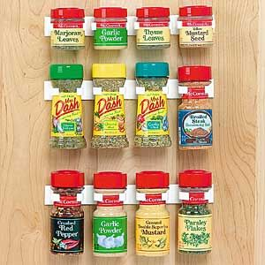 Great solution for spices.  Pin inside cabinet door for quick access to most used spice bottles.