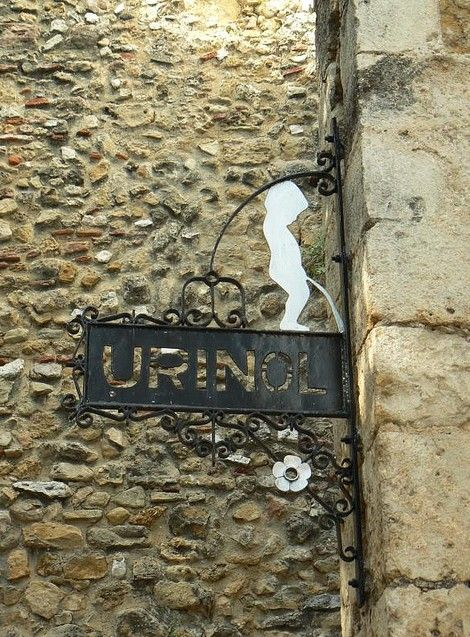 """Urinol"" (Urinal) sign in Travessa do Funil near Castelo de São Jorge, Alfama, Lisboa (Lisbon), Portugal."