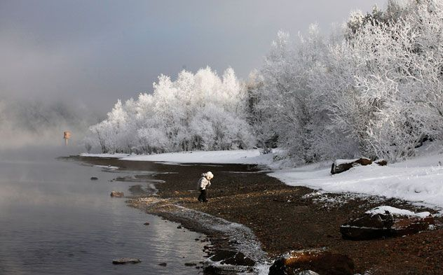A curious child walking along the bank of the Yenisei River, some 42 km south from Russia's Siberian city of Krasnoyarsk. The temperature is  about minus 23 degrees Celsius. Source: Reuters/Vostock-Photo