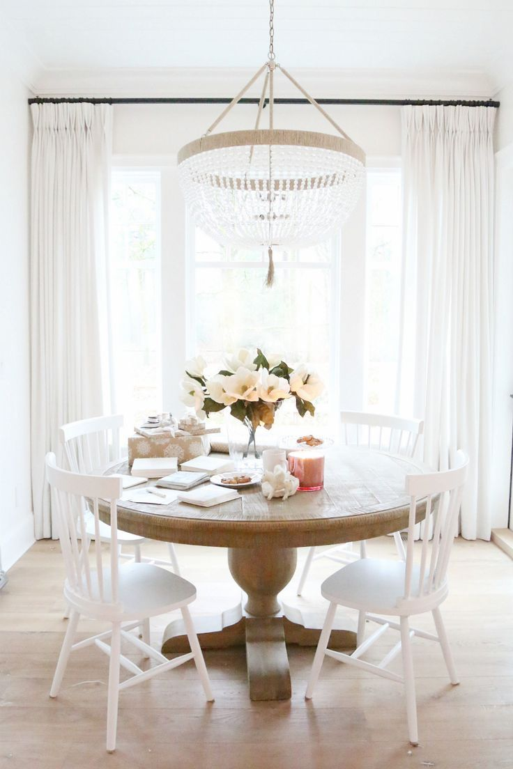 White Dining Room with beaded chandelier. Christmas Kitchen Table