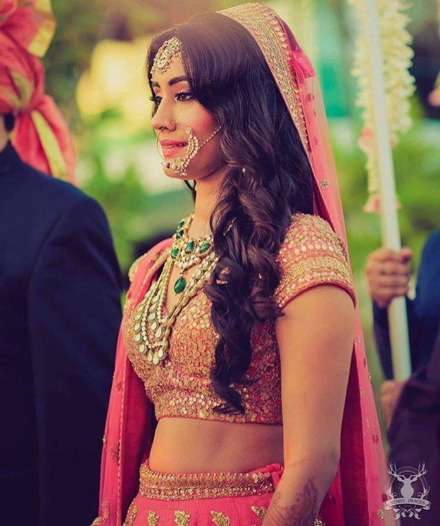 Coral lehenga, open side swept hair and that Nath, say hello to this gorgeous bride! :@morvi_images #thebridalaffair #tbai #luxury #vintage #inspiration #lehenga #nosering #blog #blogger #weddingblog #india #indianbride #indianwedding #bride #bridetobe #wedding #dream #love