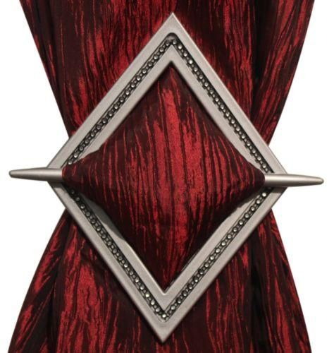 """Easily tie back your curtains, without screwing anything into the wall. Simply bunch curtain together and click with holdback. Diamond shaped holdback, Trendy beautiful design. Measures 8"""" X 6 1/2"""" with 8"""" rod. Makes for a great gift."""