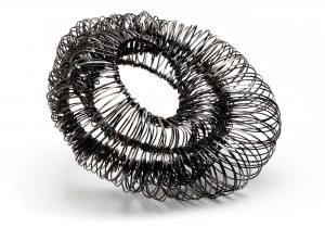Category: Jewelry  - BIBA SCHUTZ  - WYRED - One of a Kind Brooch - Using threads of wire I am creating the illusion of inside outside undulating forms. - Steel & sterling silver Dimensions: H:4.30 x W:3.80 x D:2.00 Inches
