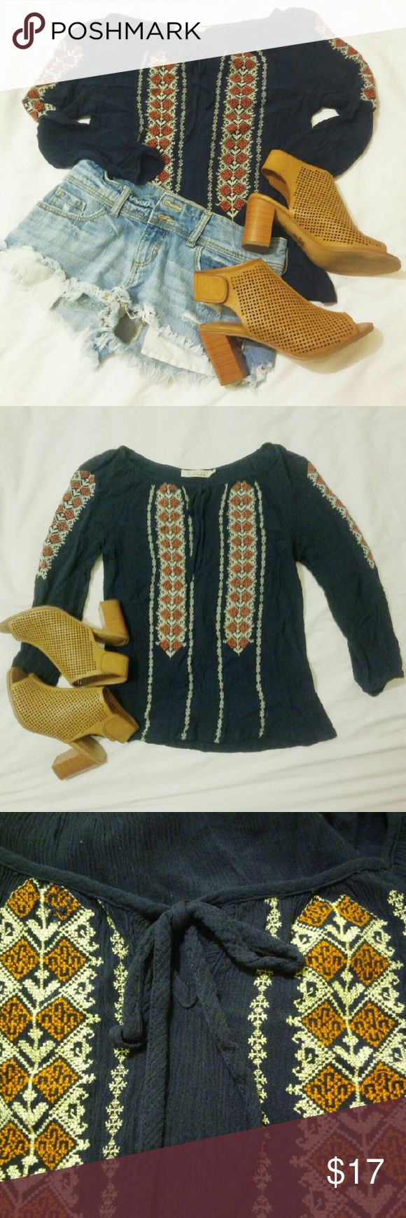 Cute Aztec Blouse Dark blue blouse. Cute aztec detailing along front and side of sleeves. Little tie at the front of shirt. solitaire Tops Blouses