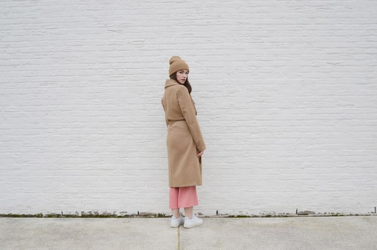 Pink culottes outfit camel coat and white veja sneakers