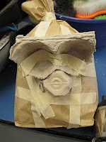 Papier-mache animal heads- using paper filled brown paper bags as armature