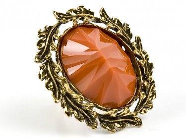 Pierścień z pomarańczowym okiem Sprawdź więcej na www.carlena.pl