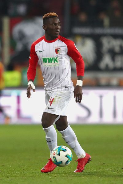 Daniel Opare of Augsburg runs with the ball during the Bundesliga match between FC Augsburg and VfL Wolfsburg at WWK-Arena on November 25, 2017 in Augsburg, Germany.