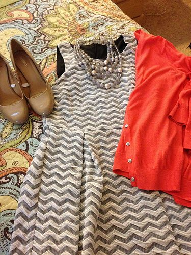 I like the cut of this dress, the chevron print, and the pop of color with the sweater.