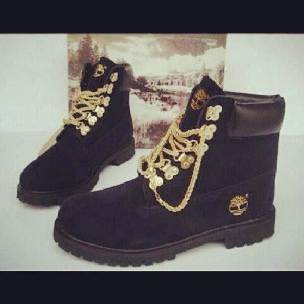 Black timberland boots with gold chains