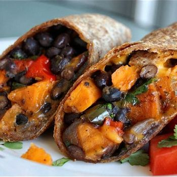 Sweet potato, black bean, and roasted pepper burritos seasoned with cilantro and lime