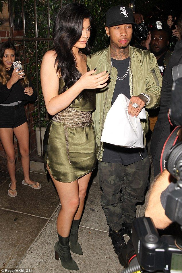 Glamorous: Kylie looked lovely in her elegant, spaghetti strap dress, featuring gold beaded detailing at the waist