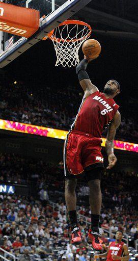 Miami Heat forward LeBron James (6) dunks in the first half of a preseason NBA basketball game against the Atlanta Hawks, Sunday, Oct. 7, 2012, in Atlanta.