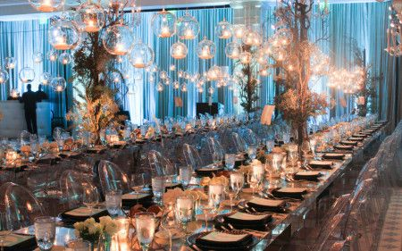 Ghost Chairs make for elegant holiday dinner design. Image via Amazing Grace Events