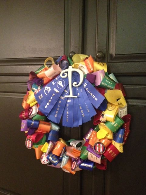 Wreath made out of award ribbons from swimming.