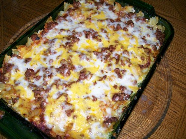 Sour Cream and Ground Beef Casserole...You can mix everything together or layer as specified. You can also choose whatever cheese you prefer. I would use a mix of cheeses as cheddar is to over powering. .