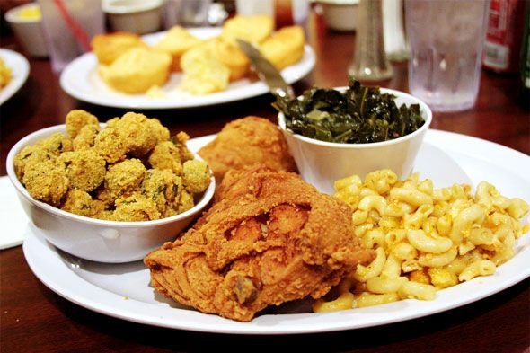 That fried chicken looks like it will just melt in your mouth.  Collard greens look just succulent.   All I need is a piece of sock it to me cake.