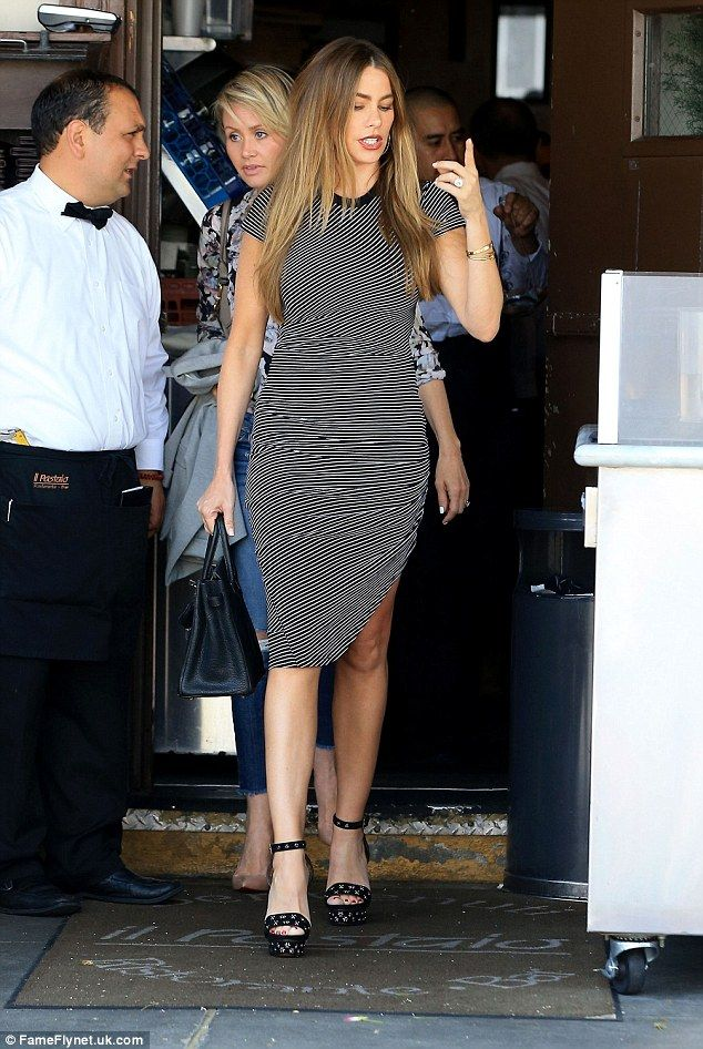 Stunning as always:Sofia Vergara looked beautiful as she showed off her famous figure in a hypnotic monochrome bodycon dress as she went for lunch at Il Pastaio in Beverly Hills on Wednesday