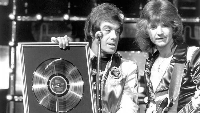 Meldrum pictured with musician Ted Mulry on Countdown in 1976.