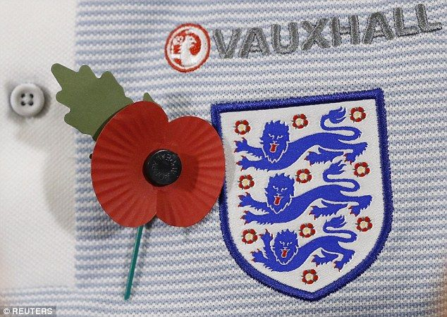 England will wear the poppy emblem on black armbands during their World Cup qualifier with Scotland at Wembley on Friday night in defiance of a FIFA ban on political symbols