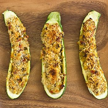 Vegetarian Stuffed Zucchini with Parmesan Panko Recipe - A vegetarian stuffed zucchini recipe with artichokes, sun-dried tomatoes, and a crispy Parmesan cheese and panko topping. Another great recipe to add to our holiday meal!