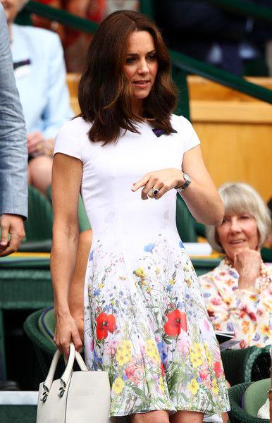 Kate Middleton Photos Photos - Catherine, Duchess of Cambridge looks on from the centre court royal box prior to the Gentlemen's Singles final between Roger Federer of Switzerland and Marin Cilic of Croatia on day thirteen of the Wimbledon Lawn Tennis Championships at the All England Lawn Tennis and Croquet Club at Wimbledon on July 16, 2017 in London, England. - Day Thirteen: The Championships - Wimbledon 2017