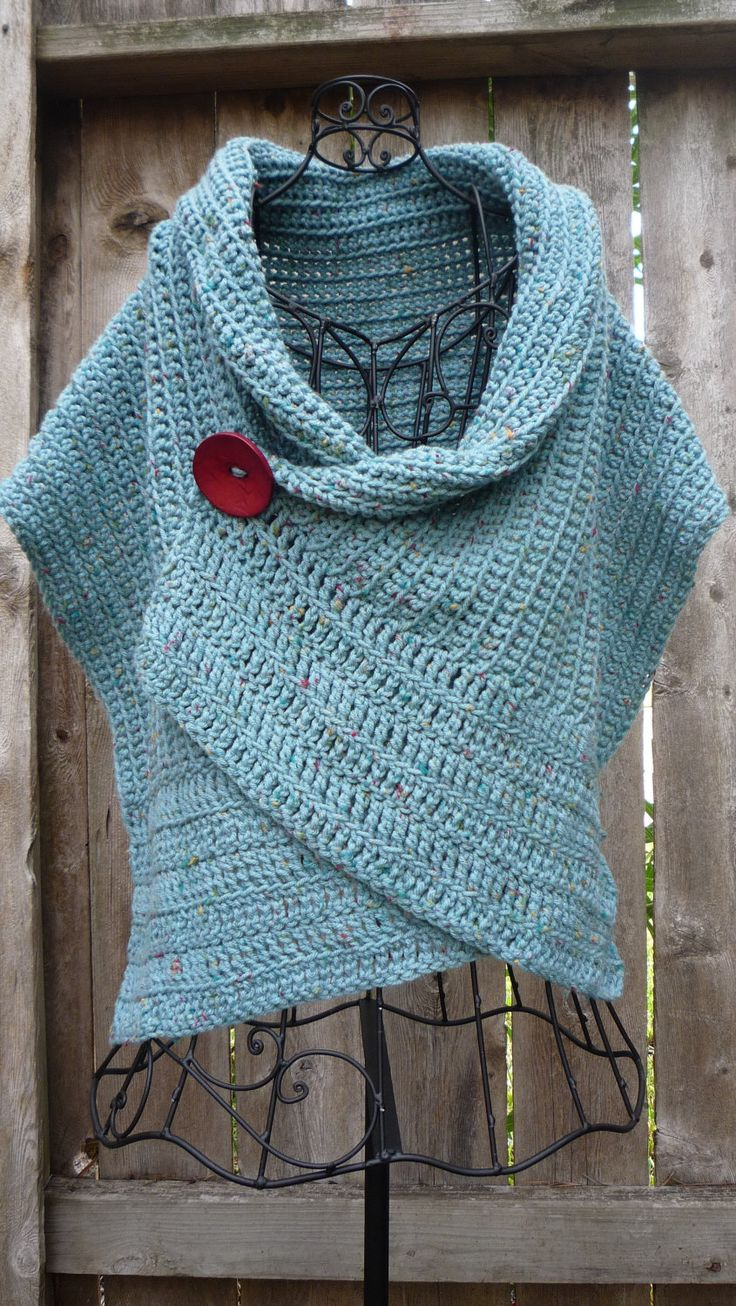 Turquoise buttoned wrap with a big red button.