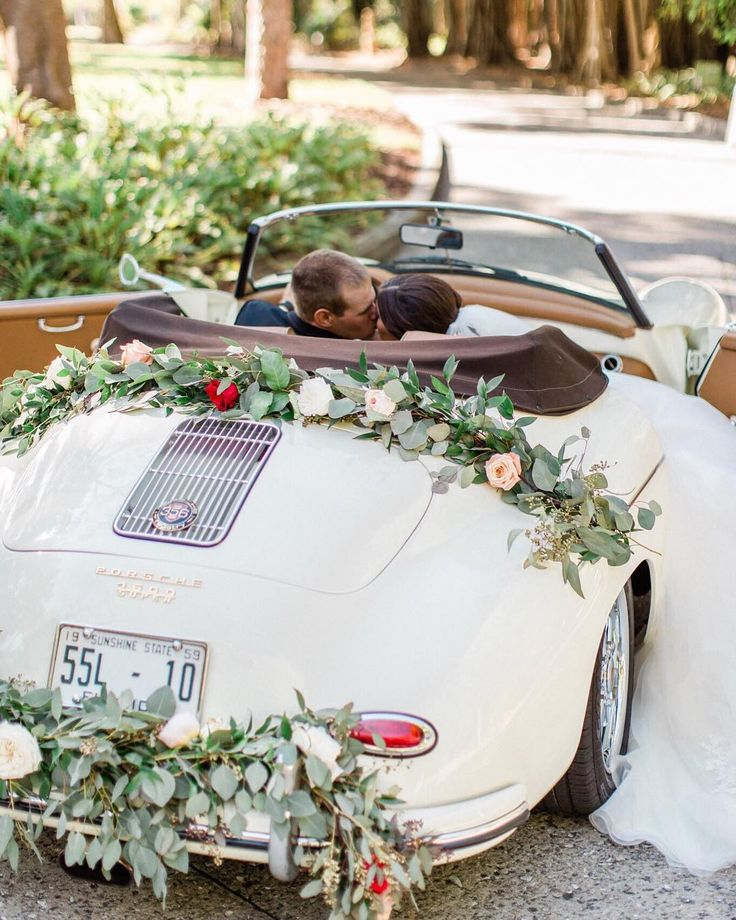 Bride & groom kissing in a 1959 Porsche Speedster at their wedding at the Ca d'z…
