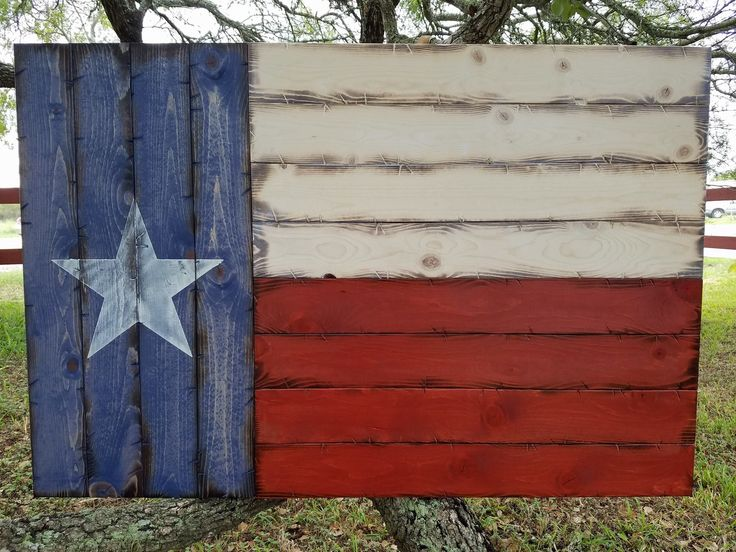 "Wooden Rustic-Style Texas Flag (Medium 21""x32""). This wooden Texas flag is made out of 12 pieces of new wood that is distressed by hand for our unique look. Then the wood is stained and the star is painted on. A clear coat is applied for protection."
