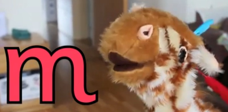 M-m-marvellous! Geraldine Giraffe looks for items that feature the letter m