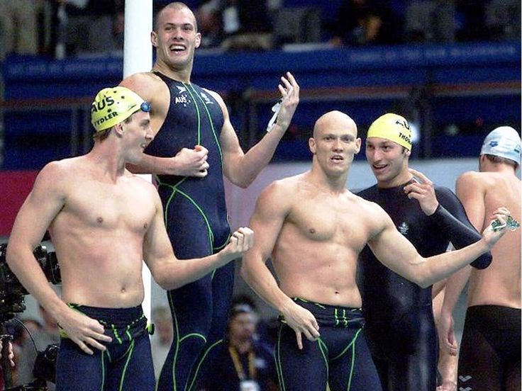2000 Sydney Olympics .. Swimmers Chris Fydler, Ashley Callus, Michael Klim and Ian Thorpe play air guitar after their victory for Australia in winning men's 4x100 freestyle relay final of Sydney 2000 Olympic Games.