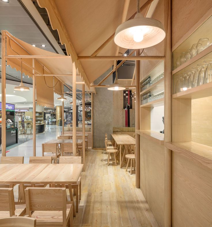 All wood interior design at Eat at Emquartier designed by Onion
